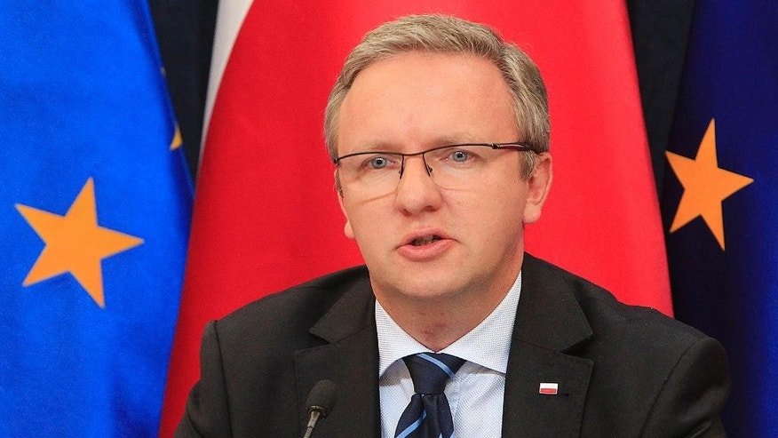 Krzysztof Szczerski, the foreign policy adviser of new Polish President Andrzej Duda  announces that Duda will make his first trips to Tallin, Estonia and to Berlin, during a news conference at the Presidential Palace in Warsaw, Poland, Monday, Aug. 17, 2015. (AP Photo/Czarek Sokolowski)