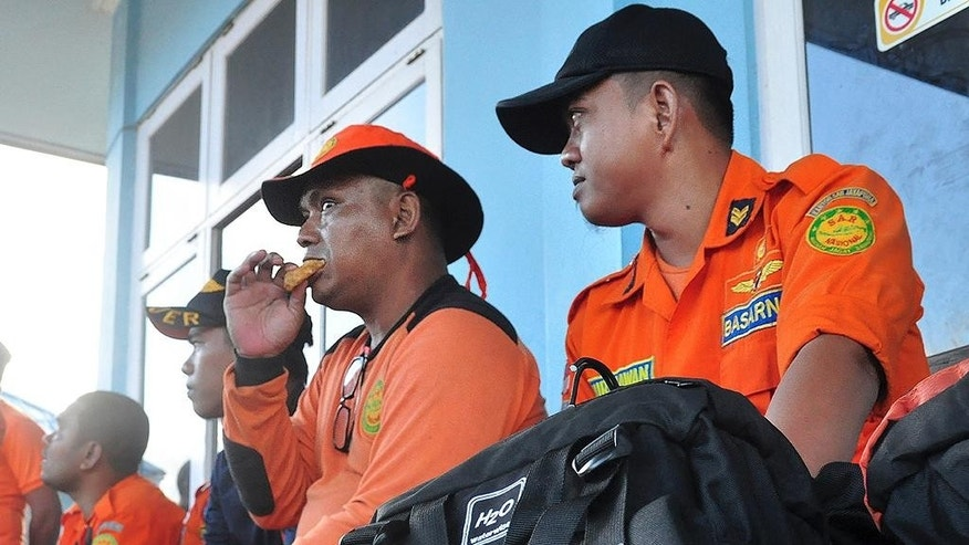 Members of  the National Search and Rescue Agency (BASARNAS) wait before leaving on a search for the missing Trigana Air Service flight at Sentani airport in Jayapura, Papua province, Indonesia, Monday, Aug. 17, 2015. Rescue officials spotted an Indonesian airliner that went missing in the country's mountainous easternmost province of Papua and rescue teams were preparing to try to reach the crash site by air and foot. (AP Photo)