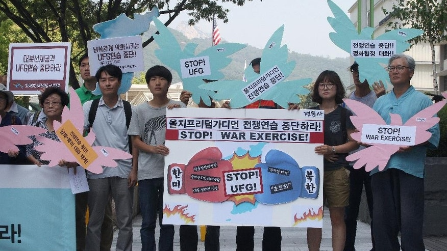 "South Korean protesters stage a rally demanding to stop the joint military exercises, Ulchi Freedom Guardian or UFG, between the U.S. and South Korea near the U.S. Embassy in Seoul, South Korea, Monday, Aug. 17, 2015.  The UFG exercise kicked off Monday for a 12-day run to prepare for a possible North Korea's attack. A banner, center, reads "" Stop Ulchi Freedom Guardian exercise."" (AP Photo/Ahn Young-joon)"