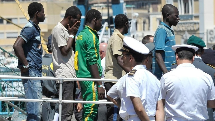 Migrants disembark from the Norwegian ship Siem Pilot at Catania harbor, Italy, Monday, Aug. 17, 2015. The Siem Pilot, which is participating in a European rescue-and-patrol mission in the Mediterranean, is bringing 49 bodies and more than 300 survivors rescued by an Italian Navy vessel from an overcrowded smuggling boat off the Libyan coast Saturday, Aug 15. (AP Photo/Carmelo Imbesi)