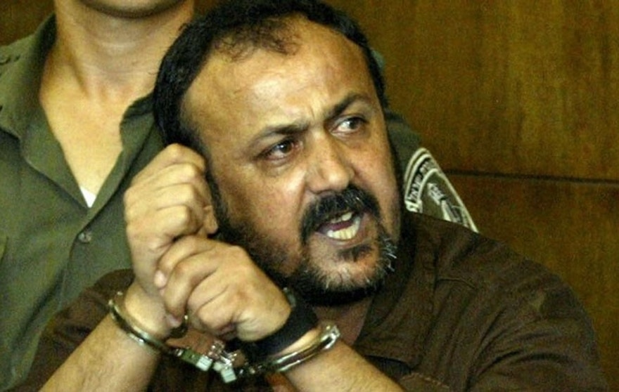 "Marwan Barghouti, 43, (R), general secretary of Palestinian [President Yasser Arafat's Fatah ] movement in the West Bank, speaks to the press as his attourney Jamal Bulous (L) tries to stop him at Tel Aviv's city court on August 14, 2002. Shouting in Hebrew, ""the Intifada will win"", Marwan Barghouti entered the Israeli court on Wednesday to face murder charges in Israel's first civilian trial of a popular leader of Palestinian uprising. - RTXLG9J"