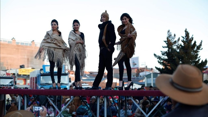 Models wear creations made of alpaca and llama wool during a fashion show at the annual Camelid Expo fair in El Alto, Bolivia, Sunday, Aug. 16, 2015. Llamas and alpacas are native to the Andes in South America, particularly Bolivia, Argentina, Chile and Peru. The llama is Bolivia's national animal and featured on the national coat of arms. (AP Photo/Juan Karita)