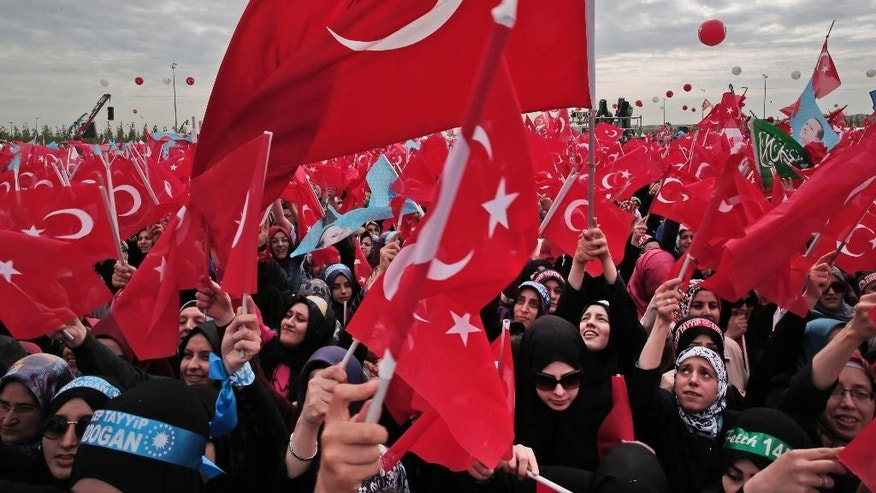 FILE - In this Saturday, May 30, 2015 file photo, vsupporters of Turkey's President Recep Tayyip Erdogan sing and wave Turkish flags as they wait for their appearance in Istanbul, during a rally to commemorate the anniversary of city's conquest by the Ottoman Turks. After his party suffered major losses in June elections, Erdogan seems to be back in control and edging Turkey towards repeat elections, and gambling that a new ballot could revive his fortunes.  (AP Photo/Lefteris Pitarakis, FILE)