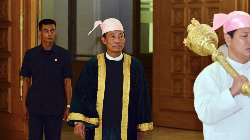 Myanmar Lower House Speaker Shwe Mann, center, arrives to attend a regular session at Parliament in Naypyitaw, Myanmar Tuesday, Aug 18, 2015. Parliament has reopened for its final session before Myanmar's nationwide election, with a spotlight on the influential speaker following his violent ouster as head of the military-backed ruling party. (AP Photo/Khin Maung Win)