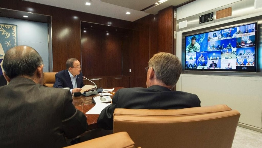 FILE -In this  Aug. 13, 2015 file photo provided by the United Nations, U.N. Secretary General Ban Ki-moon, center, speaks with U.N. Special Representatives, Force Commanders and Police Commissioners in all U.N. peacekeeping operations during a video conference at U.N. headquarters. Widespread relief greeted the resignation of Babacar Gaye, the head of the peacekeeping mission in Central Africa Republic, over the force's handling of dozens of misconduct allegations, including rape and killing. Stretched for resources with a record number of peacekeepers in the field, the U.N. has hesitated to upset member states by announcing the countries whose troops or police are accused of wrongdoing, until now. Last week, Ban announced his intention to do so. (Eskinder Debebe/United Nations via AP, File)