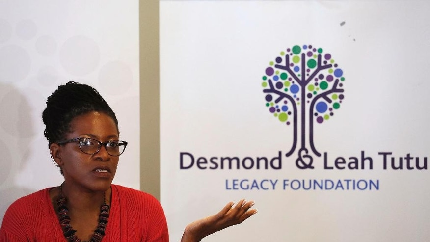 Reverend Mpho Tutu, the daughter of retired South African Archbishop Desmond Tutu, speaks to media during a press briefing in Cape Town, South Africa, Tuesday, Aug. 18, 2015. Tutu is back in a hospital for the third time in recent months. Tutu's daughter says her father is being treated for inflammation, and not for the same infection he had earlier. The 83-year-old old Tutu was hospitalized twice in July. The Nobel Peace Prize laureate has been treated for prostate cancer for many years, but his daughter says the cancer is under control. (AP Photo/Schalk van Zuydam)