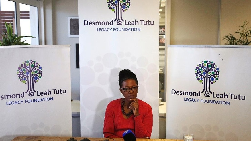 Reverend Mpho Tutu, the daughter of retired South African Archbishop Desmond Tutu, gestures during a press briefing in Cape Town, South Africa, Tuesday, Aug. 18, 2015. Tutu is back in a hospital for the third time in recent months. Tutu's daughter says her father is being treated for inflammation, and not for the same infection he had earlier. The 83-year-old old Tutu was hospitalized twice in July. The Nobel Peace Prize laureate has been treated for prostate cancer for many years, but his daughter says the cancer is under control. (AP Photo/Schalk van Zuydam)