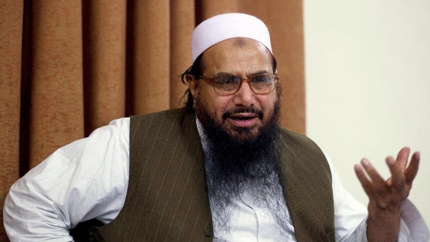FILE - In this April 3, 2012, file photo, Hafiz Mohammed Saeed, chief of Jamaat-ud-Dawwa and founder of Lashkar-e-Taiba talks with the Associated Press in Islamabad, Pakistan. The militant leader with a $10 million bounty on his head over his alleged involvement in the 2008 Mumbai terror attacks now has a new target: A Bollywood film that imagines him being targeted for assassination. (AP Photo/B.K. Bangash, File)