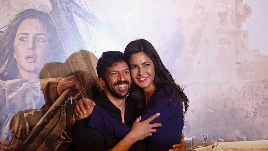 "FILE - In this Saturday, July 25, 2015, file photo, Indian Bollywood actress Katrina Kaif hugs director Kabir Khan during the trailer launch of their upcoming movie ""Phantom,"" in Mumbai, India. A Pakistani militant leader with a $10 million bounty on his head over his alleged involvement in the 2008 Mumbai terror attacks now has a new target: the Bollywood film that imagines him being assassinated. (AP Photo/Rajanish Kakade, File)"