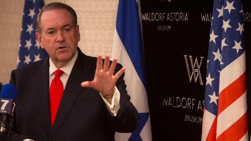 Republican presidential hopeful Mike Huckabee gestures as he speaks during a press conference in Jerusalem, Wednesday, Aug. 19, 2015. Huckabee on Wednesday vowed to abandon key American policies in the Mideast if he is elected next year, endorsing positions that would put the U.S. at odds with its closest allies. (AP Photo/Sebastian Scheiner)