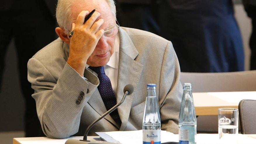 German Finance Minister Wolfgang Schaeuble waits for the beginning of a meeting of the Christian Democratic Party's parliamentary faction on the eve of Wednesday's vote on another bailout package for Greece, in the German Bundestag in Berlin, Tuesday, Aug. 18, 2015. (AP Photo/Ferdinand Ostrop)