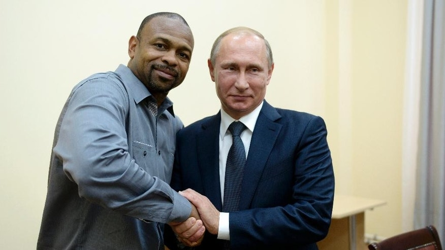 Russian President Vladimir Putin, right, meets with American boxer Roy Jones Jr. in Sevastopol, Crimea, Wednesday, Aug. 19, 2015. (Alexei Nikolsky/RIA-Novosti, Kremlin Pool Photo via AP)