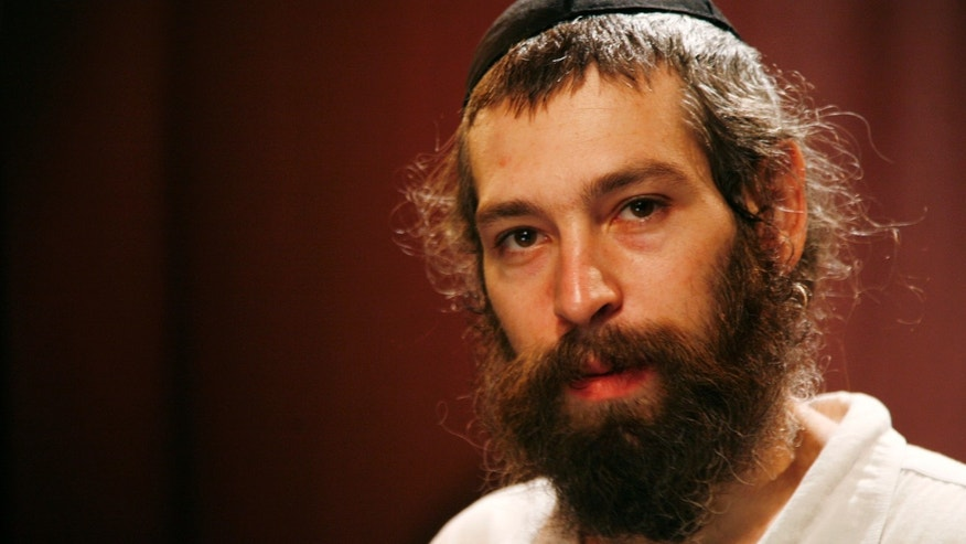 "FILE - In this Tuesday, July 28, 2009 file photo, recording artist Matisyahu poses for a portrait in New York. Organizers of an international reggae festival in Spain have canceled a concert by the Jewish American singer Matisyahu after he declined to state his position regarding a Palestinian state. Rototom Sunsplash festival organizers said on their Facebook page they canceled the Aug. 22, 2015 concert because the singer declined ""to declare himself regarding the war and in particular the right of the Palestinian people to have their own state."" (AP Photo/Jeff Christensen, File)"