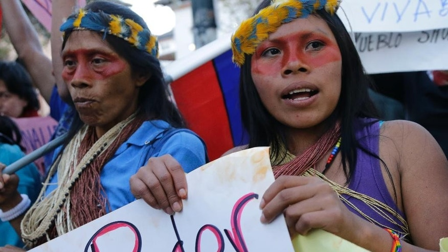 Indian women from the Amazon region of Ecuador take part in a protest march in Quito, Ecuador, Wednesday, Aug. 19, 2015. The march was called by labor unions and indigenous organizations to protests against policies of President Rafeal Correa. (AP Photo/Dolores Ochoa)