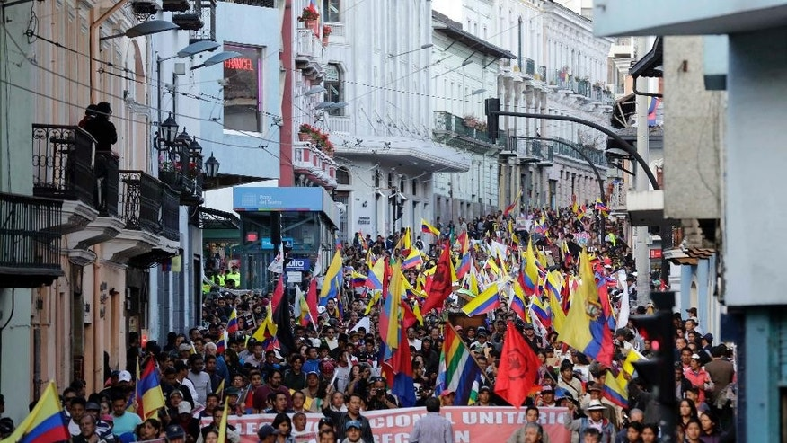 Demonstrators take part in a protest march in Quito, Ecuador, Wednesday, Aug. 19, 2015. The march was called by labor unions and indigenous organizations to protests against policies of President Rafeal Correa. (AP Photo/Dolores Ochoa)