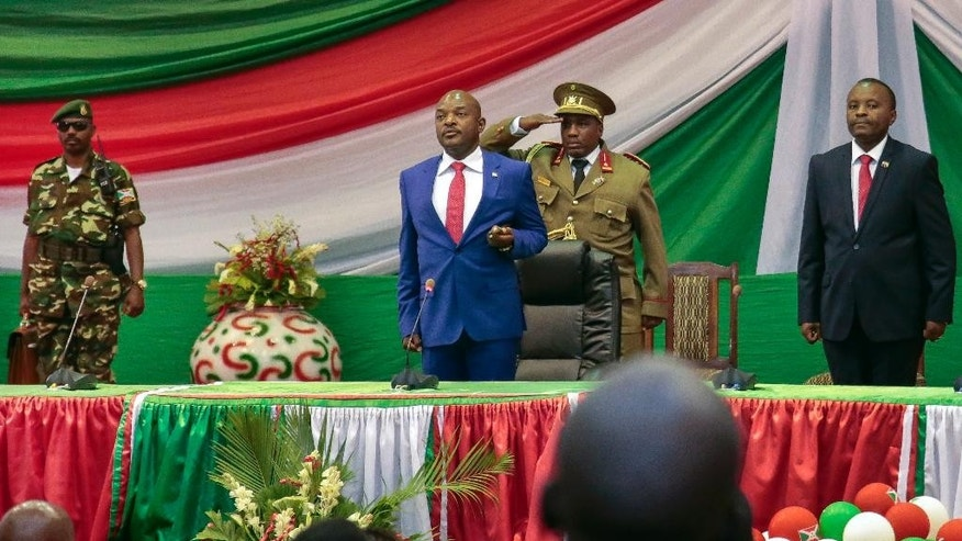 Burundi's President Pierre Nkurunziza is sworn in for a third term at a ceremony in the parliament in Bujumbura, Burundi Thursday, Aug. 20, 2015. Without any fanfare or even a public announcement beforehand, Nkurunziza was sworn in for a third term on Thursday in this central African country which has been plagued by political violence that has left more than 100 people dead and tens of thousands of refugees. (AP Photo/Gildas Ngingo)