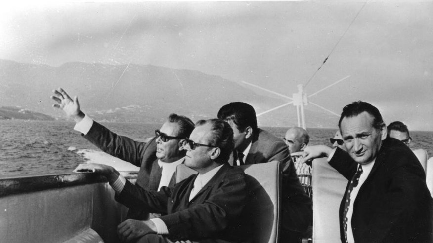 FILE - In this September 1971 file photo Soviet party chairman Leonid Brezhnev points towards the shore to visiting West German Chancellor Willy Brandt as West German State Secretary Egon Bahr, right, looks on during a boat ride on the Black Sea, Russia off the coast of Crimea. German magazine Stern reports Thursday, Aug. 20, 2015 that Bahr has died. He was 93. (AP Photo/Fritz Reiss, file)