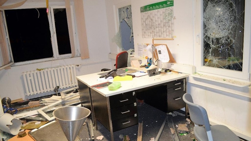 View of a destroyed office in the refugee home in Suhl, Germany,Thursday morning  Aug. 20 2015. Police say they are investigating a clash at the  asylum-seekers' home in which 11 refugees and three police officers were injured late Wednesday. Police say some 50 residents were involved and as many more watched the clash. ( Martin Wichmann/dpa via AP)