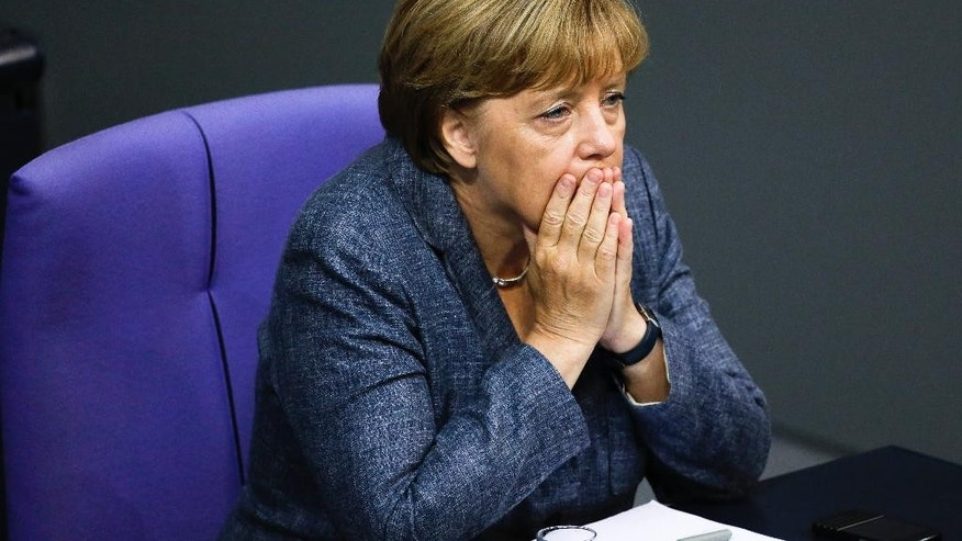 German Chancellor Angela Merkel attends a debate at the German parliament prior to a vote on another bailout package for Greece, in the German Bundestag in Berlin, Wednesday, Aug. 19, 2015. (AP Photo/Markus Schreiber).
