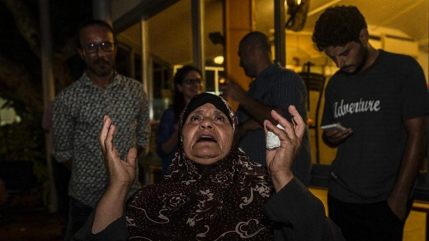 Mazoza Allan, mother of Palestinian hunger striker Mohammed Allan reacts to a Supreme Court decision outside Barzilai hospital in Ashkelon, southern, Israel, Wednesday, Aug. 19, 2015. Israel's Supreme Court on Wednesday suspended the detention order for Allan who has been on a hunger strike for more than two months, releasing him while he receives medical care in a decision hailed by relatives and supporters as a victory. (AP Photo/Tsafrir Abayov)