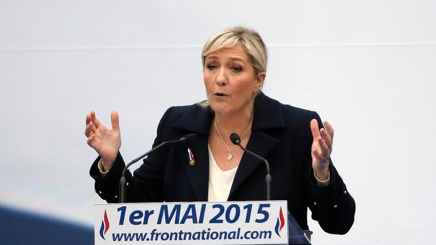FILE - In this May 1, 2015 file photo, France's far-right National Front president Marine Le Pen delivers her speech during May Day march, in Paris, France. Her father Jean-Marie Le Pen risks suspension or exclusion Thursday Aug.20, 2015 from the far-right National Front he helped found more than four decades ago as his daughter begins a new effort to oust him. Le Pen, 87, was summoned by daughter who has said she will not be present at the high-stakes meeting . (AP Photo/Francois Mori, File)