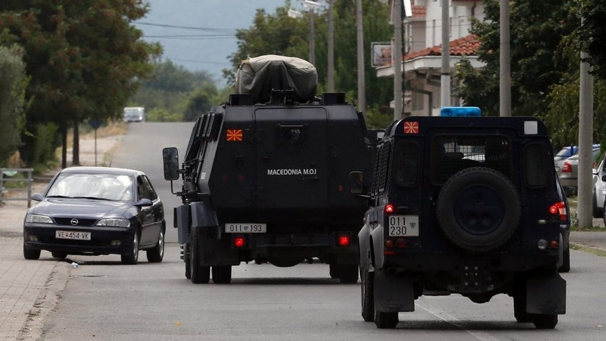 Police vehicles drive to the border between Greece and Macedonia in the southern Macedonian town of Gevgelija, Thursday, Aug. 20, 2015. Macedonian  police  stepped up the security at the border with Greece apparently trying to stem recent surge of migrants who are coming from Greece. (AP Photo/Darko Vojinovic)