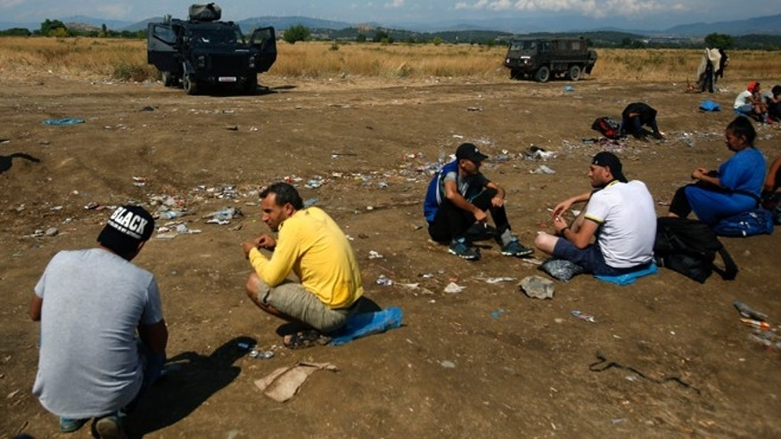 Aug. 20: Macedonian police block migrants at no-man's land between Greece and Macedonia near the southern Macedonian town of Gevgelija.