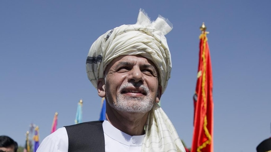 """In this Wednesday, Aug. 19, 2015 photo, Afghanistan President Ashraf Ghani listens to the national anthem after putting flowers on the """"Independence Minaret"""" monument during an Independence Day ceremony in Kabul, Afghanistan. While leaders of the Afghan Taliban meet to resolve the leadership turmoil that has engulfed the group since their one-eyed leader Mullah Mohammad Omar was revealed to be dead, Afghanistan's relationship with Pakistan is deteriorating at a dangerous juncture in the war, with the neighboring countries trading blame for stoking tensions and President Ashraf Ghani accusing Islamabad of sponsoring the insurgency now nearing its 14th year with almost 5,000 civilian deaths so far this year.  (AP Photo/Massoud Hossaini)"""