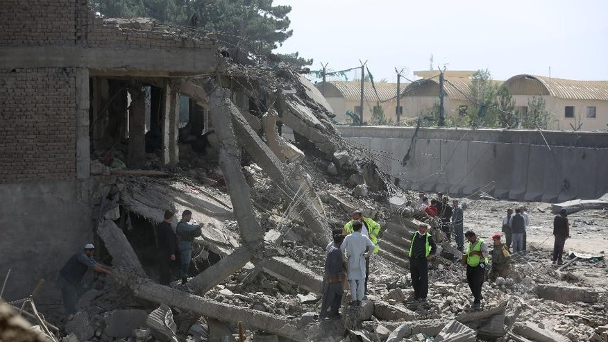 In this  Friday, Aug. 7, 2015, photo, Afghan security personnel inspect the site of a car bomb attack in Kabul, Afghanistan. While leaders of the Afghan Taliban meet to resolve the leadership turmoil that has engulfed the group since their one-eyed leader Mullah Mohammad Omar was revealed to be dead, Afghanistan's relationship with Pakistan is deteriorating at a dangerous juncture in the war, with the neighboring countries trading blame for stoking tensions and President Ashraf Ghani accusing Islamabad of sponsoring the insurgency now nearing its 14th year with almost 5,000 civilian deaths so far this year. (AP Photo/Rahmat Gul)