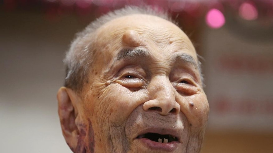 Yasutaro Koide, the 112-year-old living in the central Japanese city of Nagoya, smiles upon being formally recognized as the world's oldest man by the Guinness World Records at a nursing home in Nagoya Friday, Aug. 21, 2015. Koide was born on March 13, 1903 and worked as a tailor when he was younger. He became the world's oldest man with the death of Sakari Momoi of Tokyo in July at age 112. (AP Photo/Koji Sasahara)