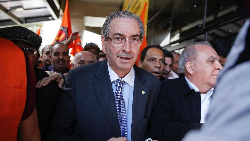 President of Brazil's Chamber of Deputies Eduardo Cunha arrives for a meeting with union workers in Sao Paulo, Brazil, Friday, Aug. 21, 2015.  Brazil's attorney general filed corruption charges Thursday against the speaker of the lower house of congress for his alleged involvement in a massive corruption scandal at the country's state-run oil company Petrobras. (AP Photo/Andre Penner)