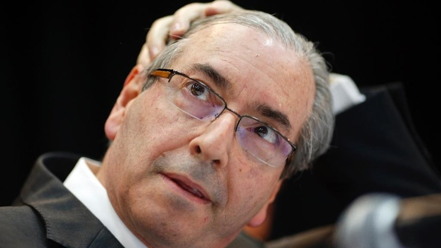 Eduardo Cunha, president of Brazil's Chamber of Deputies, attends a meeting with union workers in Sao Paulo, Brazil, Friday, Aug. 21, 2015. Brazil's attorney general filed corruption charges Thursday against the speaker of the lower house of congress for his alleged involvement in a massive corruption scandal at the country's state-run oil company Petrobras. (AP Photo/Andre Penner)