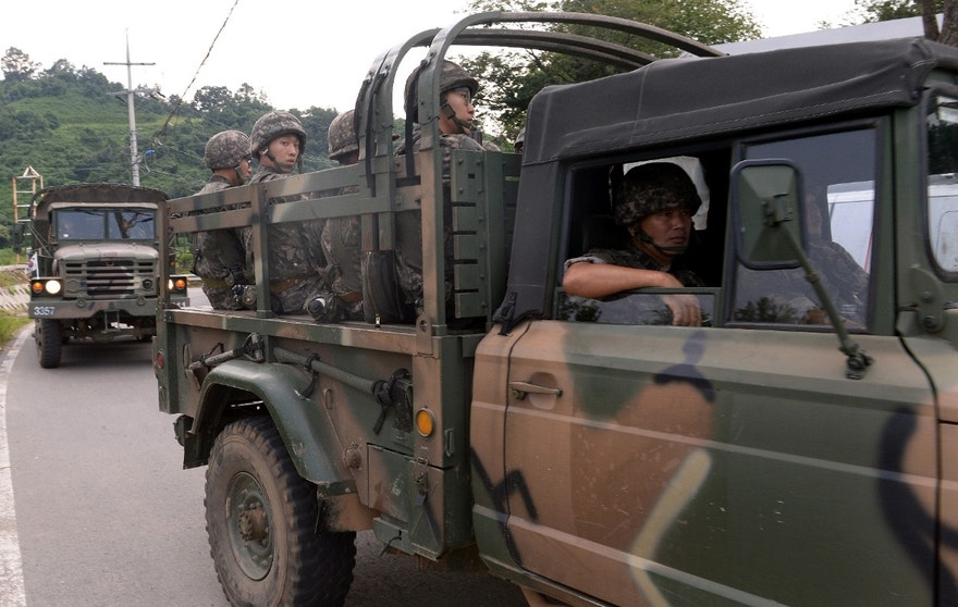 "Aug. 21, 2015 - South Korean army soldiers ride on a truck in Yeoncheon, south of the demilitarized zone that divides the two Koreas. North Korean leader Kim Jong Un on Friday declared his frontline troops in a ""quasi-state of war"" and ordered them to prepare for battle."