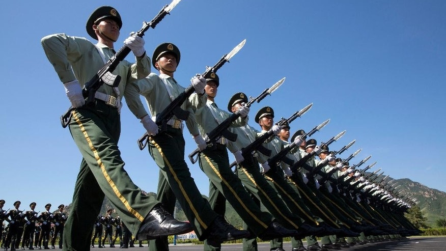 Chinese troops practice marching ahead of a Sept. 3 military parade at a camp on the outskirts of Beijing, Saturday, Aug. 22, 2015. China is ramping up publicity for its upcoming World War II military parade that will feature 12,000 soldiers and 500 pieces of military equipment, but officials still aren't saying which other countries are taking part in the spectacle. (AP Photo/Ng Han Guan)
