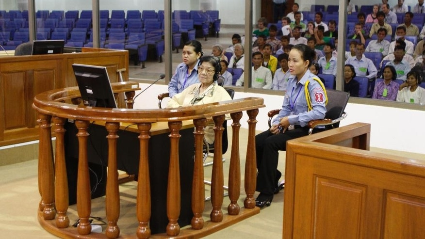 In this file photo dated Feb. 15, 2010, Ieng Thirith, center, the Khmer Rouge's former Social Affairs Minister and wife to Ieng Sary, the communist group's former Foreign Minister, looks on inside the courtroom of the U.N.-backed tribunal during a hearing, on the outskirts of Phnom Penh, Cambodia. Ieng Thirith, a Khmer Rouge leader who was the highest-ranking woman in the genocidal regime that oversaw the death of nearly 2 million Cambodians in the late 1970s, has died on Aug. 22, 2015. She was 83 years old. (AP Photo/Henh Sinith, FILE)