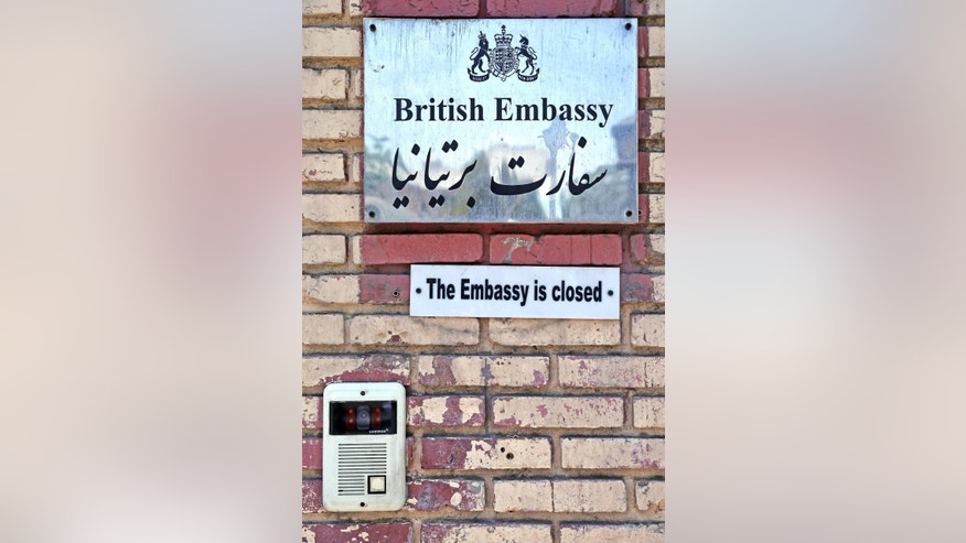 The British Embassy plaque in Tehran, Iran, Saturday, Aug. 22, 2015. Iranian state-run media has reported the British Embassy in Tehran will reopen Sunday. The embassy has been closed for almost four years after hard-liners protesting the imposition of international sanctions over Iran's contested nuclear program stormed it in November 2011. (AP Photo/Ebrahim Noroozi)