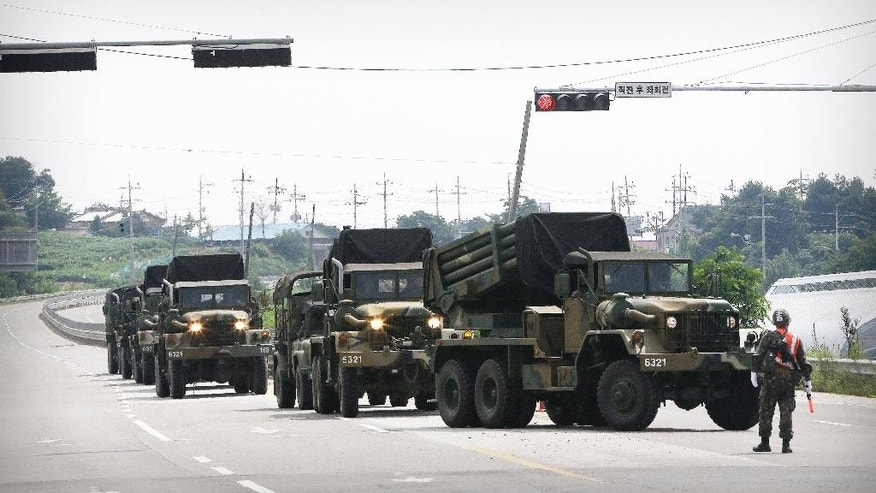 South Korean army's armored vehicles move in Yeoncheon, south of the demilitarized zone that divides the two Koreas, South Korea, Saturday, Aug. 22, 2015. The two Koreas prepared for a possible military clash Saturday as the North's deadline loomed for Seoul to dismantle loudspeakers broadcasting anti-North Korean propaganda across their border. North Korea has declared its frontline troops are in full war readiness and prepared to go to battle if Seoul doesn't back down. (AP Photo/Ahn Young-joon)