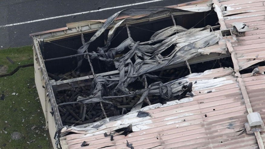 Aug. 24, 2015: U.S. Army Sagami Depot in Sagamihara, southwest of Tokyo is damaged after multiple explosions and a large fire. (Kyodo News via AP)