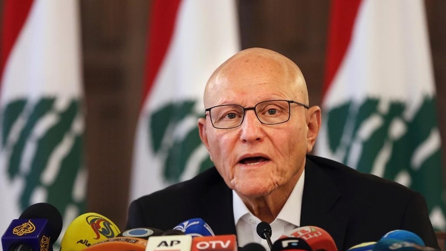 Lebanese Prime Minister Tammam Salam speaks during a press conference at the government palace in Beirut, Lebanon, Sunday, Aug. 23, 2015. Salam hinted he might resign after violent protests by people demonstrating against government corruption and political dysfunction amid a trash crisis. He said that security forces who used force against protesters will be held accountable and that the right to demonstrate is protected by the constitution. (AP Photo/Bilal Hussein)
