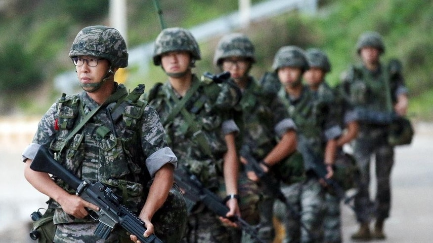 South Korean marines patrol along on Yeonpyeong island, South Korea, Sunday, Aug. 23, 2015. Senior officials from North and South Korea resumed a second round of talks on Sunday that temporarily pushed aside vows of imminent war on the peninsula.  South Korea's presidential office said the talks restarted in the border village of Panmunjom.  The delegates failed to reach an agreement in Saturday's marathon talks that stretched into the early hours of Sunday, and it was still unclear whether diplomacy would defuse what has become the most serious confrontation in years. (Yun Tae-hyun/Yonhap via AP) KOREA OUT