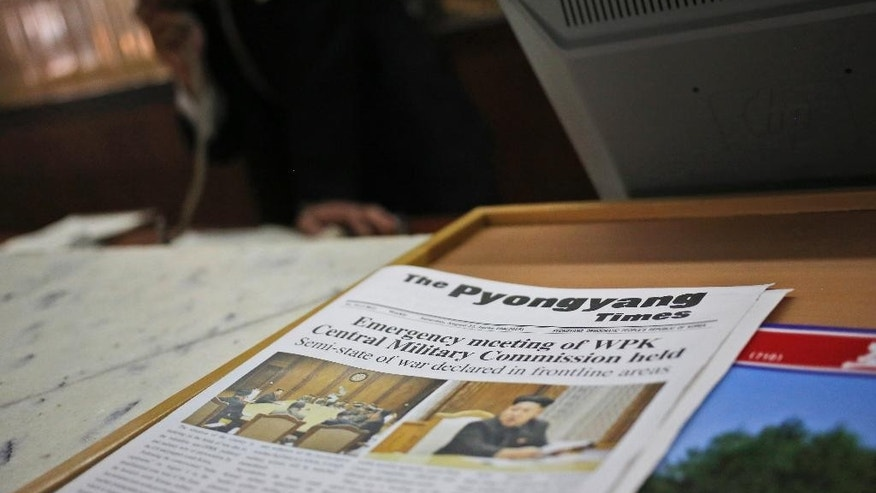 "A Saturday's copy of local English newspaper ""Pyongyang Times"" is displayed on the front desk of a hotel in Pyongyang, North Korea, Sunday, Aug. 23, 2015. North and South Korea on Sunday resumed a second round of talks that temporarily pushed aside vows of imminent war on the peninsula. (AP Photo/Dita Alangkara)"