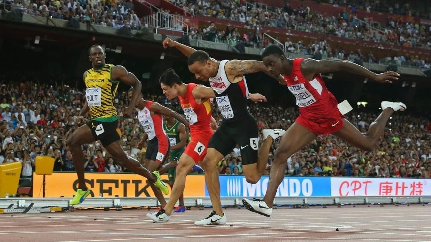 Jamaica's Usain Bolt, front, competes in a men's 100m semifinal at the World Athletics Championships at the Bird's Nest stadium in Beijing, Sunday, Aug. 23, 2015. (AP Photo/David J. Phillip)