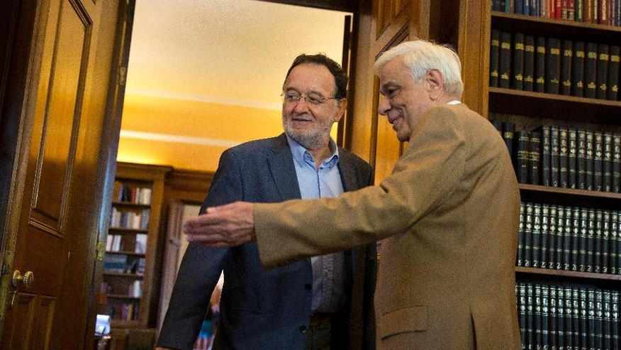 Former Energy Minister and head a party called Popular Unity , Panagiotis Lafazanis, left , is welcomed by Greek President Prokopis Pavlopoulos, in Athens, Monday Aug. 24, 2015. Lafazanis, who heads the newly-formed Popular Unity, received the maximum three-day mandate from the country's president after the head of the main opposition conservative New Democracy failed to form a government. (AP Photo/Petros Giannakouris)