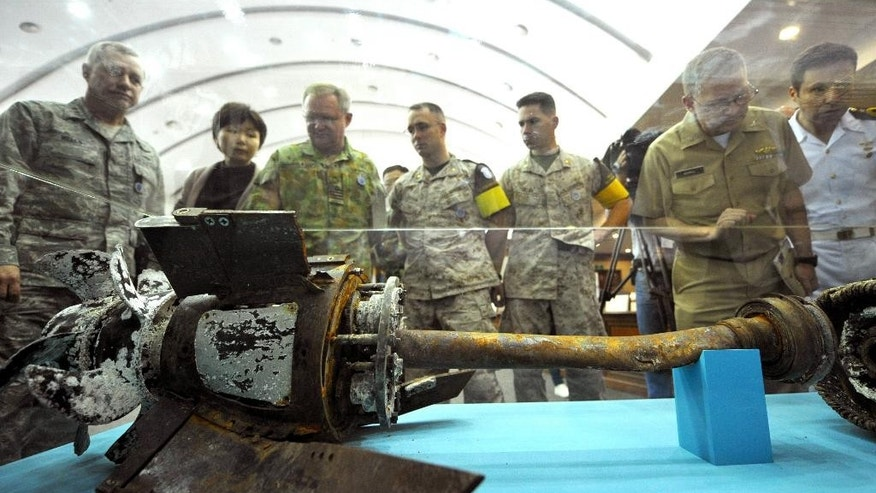 FILE - In this May 25, 2010 file photo, officers from the United Nations Command inspect a broken section of what Seoul claims to be a North Korean torpedo displayed at South Korea's Defense Ministry building after it was salvaged near the disputed sea border. Once again, the Koreas are trying to disentangle themselves from violence and threats of war in Aug. 2015- this time in tense talks that have dragged out in two marathon sessions over three days. Skepticism over success abounds, but the rivals have proven time and again over the decades their mastery at pulling back from the brink. (Kim Jae-hwan/Pool via AP, File)