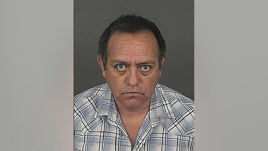 Jason Martinez is seen in this Denver Police Department booking photo dated July 18, 2013, in Denver, Colo.