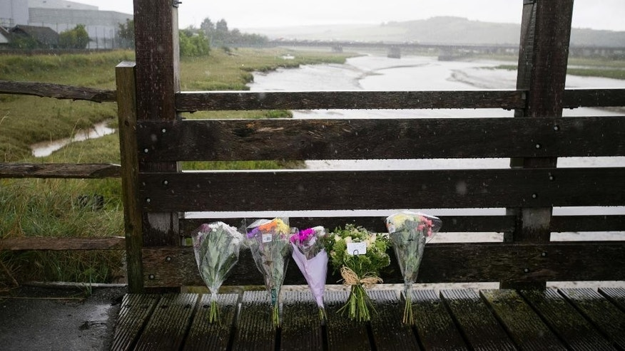 "Flowers are placed on the Shoreham Tollbridge that crosses the River Adur near the location where a Hawker Hunter fighter jet crashed on a busy road near Shoreham-by-sea, West Sussex, England, Sunday, Aug. 23, 2015. British police on Sunday said the death toll from an airshow crash is ""highly likely"" to increase after a fighter jet slammed into a busy main road on Saturday. The initial death toll was seven. (Daniel Leal-Olivas/PA Wire via AP) UNITED KINGDOM OUT, NO SALES, NO ARCHIVE"