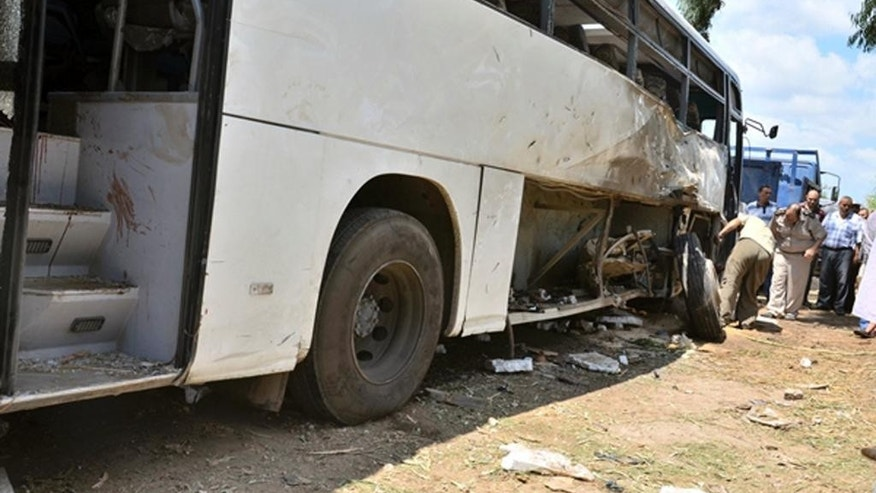 Security personnel inspect a bus that was damaged in a deadly roadside bombing in the Nile Delta province of Beheira, Egypt, early Monday morning, Aug. 24, 2015. The blast that killed several policemen and wounded dozens of others targeted a bus carrying conscripts, police Brig. Gen. Khaled al-Hameed said. (AP/Photo)