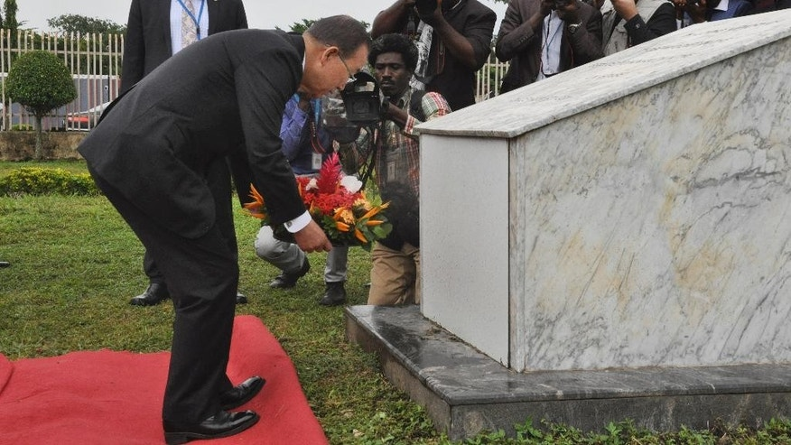 U.N. Secretary General Ban Ki-Moon, lays a wreath at the U.N headquarters in Abuja to remember his colleagues that were killed four years ago by a suicide car bombing in Abuja Nigeria Monday, Aug. 24, 2015. (AP Photo/Gbemiga Olamikan)
