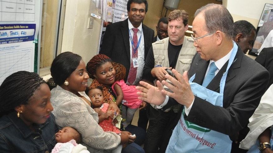 U.N. Secretary General Ban Ki-Moon, meets with women and children at a health centre in  Abuja Nigeria Monday, Aug. 24, 2015. The Secretary General  met Nigerian President Muhammadu Buhari and promised solidarity in the new Nigerian leader's fight against insecurity, unemployment and corruption. (AP Photo/Gbemiga Olamikan)