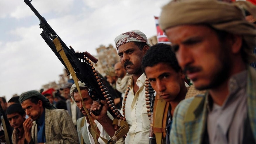 A Shiite Houthi rebel holds his weapon as he attends a rally to protest Saudi-led airstrikes, in Sanaa, Yemen, Monday, Aug. 24, 2015. The Saudi-led coalition fighting Shiite rebels in Yemen doubled its near-daily airstrikes in the central province of Marib and the adjacent border area of Jawf on Monday, paving the way for allies on the ground to push north toward Shiite rebel strongholds, military and security officials said. (AP Photo/Hani Mohammed)